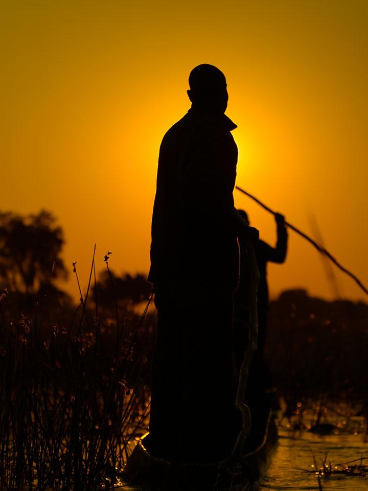 ZA131458-Mokoro-transport-through-the-Okovango-delta-at-dusk.-.jpg