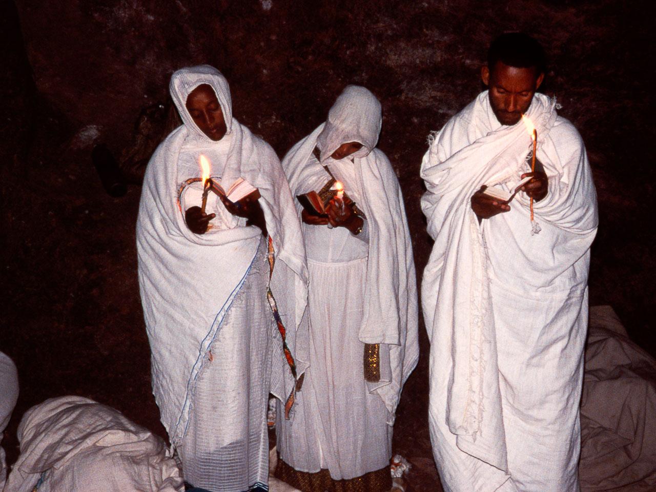 ET05009-Lalibela-Pilgrims-with-candles-at-Leddet.jpg