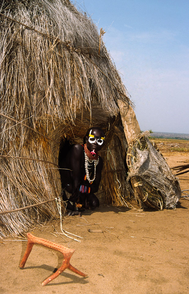 ET05186-A-Karo-emerging-from-his-hut.jpg